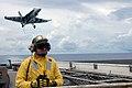 US Navy 070811-N-7883G-008 An arresting gear officer watches flight operations on USS Kitty Hawk's (CV 63) flight deck.jpg