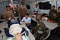 US Navy 070815-N-0989H-027 Sailors attached to Task Group 40.9 provide training to Guatemalan naval officers, sailors and Marines on the proper procedures for inserting an IV into a CPR dummy.jpg