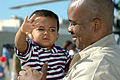 US Navy 070827-N-4047W-041 Senior Chief Yeoman Ken Edgerton holds his son at the homecoming ceremony for Helicopter Antisubmarine Squadron (HS) 8.jpg