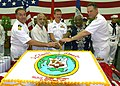 US Navy 070901-N-9421C-068 Pacific Partnership - Capt. Scott Flinn, Ambassador Clyde Bishop, Minister Witten T. Philippo, Capt. Bruce Stewart and Capt. Ed Rhoades on USS Peleliu.jpg
