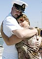 US Navy 070910-N-5411L-141 Chief Operations Specialist John Hershey, assigned to guided-missile frigate USS Gary (FFG 51), hugs his wife after returning from Yokosuka, Japan.jpg