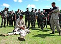 US Navy 070928-N-1120L-040 Lance Cpl. Ganesh Tulshi demonstrates how to subdue a suspected insurgent played by Cpl. Christopher Briscoe.jpg