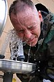 US Navy 080826-N-1057H-037 Lt. Cmdr. (Sel.) Stephen Legg washes CS gas off his face..jpg