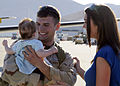 US Navy 081007-N-9584N-015 On the flight line of Naval Air Station Point Mugu, Builder 2nd Class Ross Amend holds his daughter Leah for the first time.jpg