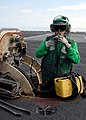 US Navy 081229-N-9900B-006 Aviation Boatswain's Mate (Equipment) Airman Melissa Pyle mans a jet blast deflector station on the flight deck of the aircraft carrier USS Theodore Roosevelt (CVN 71).jpg