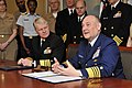 US Navy 090401-N-8273J-022 Commandant of the Coast Guard Adm. Thad W. Allen, right, delivers remarks as Chief of Naval Operations (CNO) Adm. Gary Roughead looks on after the signing of the memorandum of agreement for the Safe H.jpg