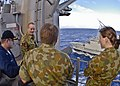 US Navy 090711-N-9950J-268 Cmdr. Michael Picio talks with a group of Australian Navy officers aboard the forward-deployed amphibious assault ship USS Essex (LHD 2) during an underway replenishment with the Australian underway r.jpg