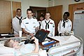 US Navy 090824-N-3271W-110 Sailors assigned to U.S. Strategic Command and Navy Operational Support Center visit with a patient at Children's Hospital Of Omaha.jpg