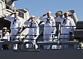 US Navy 090914-N-6674H-004 Sailors aboard the guided-missile destroyer USS Hopper (DDG 70) render a hand salute as they depart Naval Station Pearl Harbor for a scheduled deployment to the U.S. 5th Fleet area of responsibility.jpg