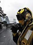 US Navy 091205-N-6003P-426 An aircraft director communicates with flight deck control on the flight deck of the aircraft carrier USS Harry S. Truman (CVN 75). Harry S. Truman is underway conducting carrier qualifications.jpg