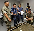 US Navy 100615-N-9643W-230 Sgts. Juan Martinez and Edan Valkner evaluate a 3D-model terrain with members of the Nicaraguan military during a subject matter expert exchange.jpg