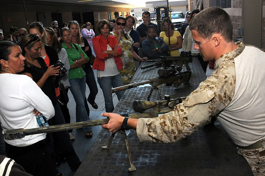 US Navy 100729-N-4301H-602 A U.S. Navy SEAL sniper assigned to SEAL Team 1 shows Naval special warfare ombudsmen and family support advocates the weapons SEALs use while deployed during the fifth annual Ombudsman Conference in.jpg