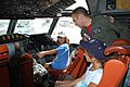 US Navy 101023-N-2425L-001 Lt. j.g. Joey Zerra, assigned to Patrol Squadron (VP) 10, shows children the cockpit of a P-3 Orion aircraft during the.jpg