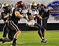 US Navy 101223-N-1722W-168 U.S. Naval Academy quarterback Ricky Dobbs (^4), tries to get past San Diego State University linebacker Miles Burris (.jpg