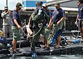 US Navy 110818-N-VA590-136 Navy Diver 2nd Class Ryan Arnold, assigned to Mobile Diving and Salvage Unit (MDSU) 2, jumps into the water at the Vasco.jpg