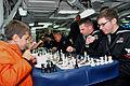 US Navy 111003-N-BS854-250 Fire Controlman 3rd Class Alexander Poehner and Sonar Technician 1st Class Joseph Whalen participate in a chess tourname.jpg