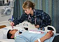 US Navy 111117-N-UB993-082 A Sailor examines a patient during drill.jpg