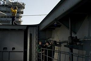 US Navy 111214-N-TZ605-103 Sailors assigned the engineering department of the Nimitz-class aircraft carrier USS Carl Vinson (CVN 70), perform maint.jpg