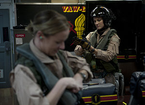 US Navy 120125-N-DR144-094 Pilot Lt. Ashley Ruic, left, and Plane Commander Lt. Cmdr. Tara Refo, both assigned to Carrier Airborne Early Warning Sq.jpg