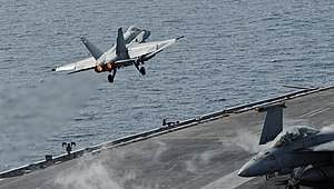 US Navy 120216-N-VO377-376 An F-A-18C Hornet assigned to the Blue Blasters of Strike Fighter Squadron (VFA) 34 launches from the flight deck of the.jpg