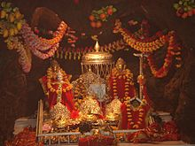 The three icons representing the three aspects of the Mother Goddess in the Vaishno Devi temple shrine.