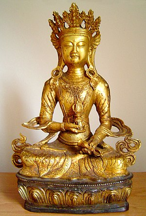 Vajrasattva - Tibetan style (Chinese, Ching Dynasty) Vajrasattva holds the vajra in his right hand and a bell in his left hand.