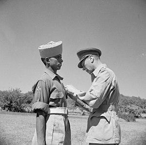 Kamal Ram - King George VI pinning the Victoria Cross on Sepoy Kamal Ram, 26 July 1944 (IWM NA17270)