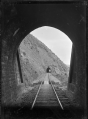 View of one railway tunnel from inside another, between Pukerua Bay and Paekakariki on the Main Trunk Line. ATLIB 274358.png
