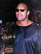 "Early life Johnson was born in Hayward, California, the son of Ata Johnson (n�e Maivia) and professional wrestler Rocky Johnson. His maternal grandfather, ""High Chief"" Peter Maivia, was also a wrestler. His maternal grandmother, Lia Maivia, was one of wrestling's few female professional promoters, taking over Polynesian Pacific Pro Wrestling after her husband's death in 1982, until 1988.[22][23] His cousin, Savelina Fanene, is also a wrestler currently working for WWE.[24] His father is a Black Nova Scotian, and his mother is of Samoan heritage.[25][26] His father was part of the first black tag team to win the World Tag Team championship in the World Wrestling Federation (WWF).[27] Through Maivia, he is considered a non-blood relative of the Anoa'i wrestling family.[28][29][30][31][32][33][34][35][36][37][38][excessive citations] Johnson briefly lived in the suburb of Grey Lynn in Auckland, New Zealand, with his mother's family.[39] He attended Richmond Road Primary School, before returning to the United States with his parents.[39] Johnson spent 10th grade at President William McKinley High School in Honolulu, Hawaii. As he entered 11th grade, his father's job required his relocation to Bethlehem, Pennsylvania. He began playing football at Freedom High School in the East Penn Conference.[26] He was also a member of the school's track and field and wrestling teams.[26] Johnson was a promising football prospect, and received offers from many Division I collegiate programs. He decided upon a full scholarship from the University of Miami to play defensive tackle. In 1991, he was on the Miami Hurricanes' national championship team.[40] After an injury kept him sidelined, he was replaced by future National Football League (NFL) star Warren Sapp.[26] While attending Miami, Johnson met his future wife, Dany Garcia, who graduated from the university in 1992 and later became a member of its Board of Trustees.[41] She also founded a Miami-based wealth management firm. In 2006, the couple donated $2 million to build a living room at the University's Newman Alumni Center. Johnson graduated from Miami in 1995, with a Bachelor of General Studies degree in criminology and physiology.[42] He joined the Calgary Stampeders of the Canadian Football League in 1995. He was on the practice roster as a backup linebacker but was cut two months into the season.[26][43][44] On November 10, 2007, Johnson returned to the Miami Orange Bowl to participate in the festivities surrounding the University of Miami's last home football game at the stadium. Professional wrestling career Training (19951996) Like his father and grandfather, several of Johnson's other (non-blood) relatives are or were professional wrestlers, including his uncles, Afa and Sika Anoaʻi (The Wild Samoans) and his cousins, Rodney (Yokozuna), Solofa (Rikishi), Matt (Rosey) and Eddie (Umaga).[39] When Johnson declared his intent to become a wrestler, his father initially resisted, but then agreed to train him himself, warning that he would not go easy on him.[26] Veteran wrestler Pat Patterson got Johnson several tryout matches with the World Wrestling Federation (WWF) in 1996. Under his real name, he defeated The Brooklyn Brawler at a house show,[45] and lost the other matches to Chris Candido and Owen Hart.[39] After wrestling at Jerry Lawler's United States Wrestling Association, as ""Flex Kavana"",[4] and winning the USWA World Tag Team Championship twice with Bart Sawyer in the summer of 1996, Johnson signed a WWF contract. He received additional training from Tom Prichard, alongside Achim Albrecht and Mark Henry.[5] World Wrestling Federation/Entertainment Rocky Maivia (19961997) Johnson made his WWF debut as Rocky Maivia, a combination of his father and grandfather's ring names, although his real name was acknowledged by the announcers.[46] He was initially reluctant to take this ring name, but was persuaded by Vince McMahon and Jim Ross.[23][47] He was given the nickname ""The Blue Chipper"", and his lineage was played to on TV, where he was hyped as the WWF's first third-generation wrestler.[2] Maivia, a clean-cut face character, was pushed heavily from the start despite his wrestling inexperience. He debuted on Monday Night Raw as a member of ""The Stalker"" Barry Windham's entourage on November 4, 1996,[48] and had his first match at Survivor Series on November 17, in an eight-man elimination tag match; he was the sole survivor.[49] WWF fans generally rejected him because of his cheesy character.[50] At In Your House 12: It's Time, Maivia defeated Salvatore Sincere in his first singles match at a pay-per-view event. On February 13, 1997, he won the Intercontinental Championship from Hunter Hearst Helmsley on Monday Night Raw.[51][52][53] Maivia successfully defended the title at In Your House 13: Final Four against Hunter Hearst Helmsley and at WrestleMania 13 against The Sultan. He defeated Bret Hart by disqualification in a title defense on March 31 episode of Raw.[54] On April 20, at In Your House 14: Revenge of the 'Taker, he lost to Savio Vega by countout, retaining the title for the final time. Audiences became increasingly hostile toward Maivia, with chants of ""Die, Rocky, die!"" and ""Rocky sucks!"" being heard during his matches.[1][4][23] The Nation of Domination (19971998) Main article: Nation of Domination After losing the Intercontinental Championship to Owen Hart on April 28, 1997 Raw Is War,[55] and suffering a knee injury in a match against Mankind,[1] Maivia returned as a heel. Along with Faarooq, D'Lo Brown, and Kama, he formed a stable called the Nation of Domination.[56] During this time, he refused to acknowledge the ""Rocky Maivia"" name, instead referring to himself in the third person as ""The Rock"". He insulted the audience in his promos, as well as WWF television interviewers, once calling Kevin Kelly an ""ugly hermaphrodite"".[56] At D-Generation X: In Your House, Stone Cold Steve Austin defeated The Rock in under six minutes to retain the Intercontinental Championship.[57] The next night, on Raw Is War, Austin was ordered by Mr. McMahon to defend the title in a rematch, but forfeited it to The Rock instead, handing him the belt before hitting him with the Stone Cold Stunner.[58][59] The Rock feuded with Austin and Ken Shamrock through the end of 1997 and beginning of 1998.[60][61] In March 1998, The Rock overthrew Faarooq as leader of the Nation of Domination, sparking a feud. He successfully defended the Intercontinental title against Faarooq at Over the Edge: In Your House on May 31, 1998.[62] He and The Nation then feuded with Triple H and D-Generation X (DX). The two stable leaders first had a two out of three falls match at Fully Loaded: In Your House for the Intercontinental title, which The Rock retained in controversial fashion.[63] This led to a ladder match at SummerSlam, in which Triple H won the title.[64] At Breakdown: In Your House, The Rock defeated Ken Shamrock and Mankind in a triple threat steel cage match to become the number one contender for the WWF Championship. He then feuded with fellow Nation member Mark Henry, effectively breaking up the stable.[65][66] The Corporation (19981999) Main article: The Corporation         As part of The Corporation, The Rock feuded with Stone Cold Steve Austin and stole Austin's personalized WWF Championship, the Smoking Skull belt.   The Rock's entertaining promos and ensuing popularity led to a face turn, in which he called himself ""The People's Champion"". This led to a feud with Mr. McMahon, who said he had ""a problem with the people"" and would thus target ""The People's Champion"". A double turn occurred at Survivor Series, when The Rock defeated McMahon's associate, Mankind, in the finals of the ""Deadly Game"" tournament[67] for the vacant WWF Championship in a fashion reminiscent of the Montreal Screwjob.[67][68][68] The Rock allied with Vince and Shane McMahon as the crown jewel of their stable, The Corporation.[67][69] On December 13, 1998, at the pay-per-view named for him, Rock Bottom: In Your House, The Rock had a rematch with Mankind for the WWF Championship. Mankind appeared to win the match when The Rock passed out in the Mandible Claw submission move, but Mr. McMahon ruled that since The Rock did not tap out, he retained his title.[69][70] The Rock continued to feud with Mankind over the WWF Championship, which was traded back and forth between them. First, in the main event of January 4, 1999 Raw Is War, Mankind defeated The Rock after interference from Steve Austin.[71] Then, in an ""I Quit"" match at Royal Rumble on January 24, The Rock regained the title, when a recording of Mankind saying ""I quit"" from an earlier interview was played over the PA system.[72][73] On Halftime Heat (an episode of Sunday Night Heat aired in the same timeslot as the Super Bowl XXXIII halftime show) on January 31, Mankind pinned The Rock using a forklift truck in an empty arena match.[74] The two faced off again, at St. Valentine's Day Massacre: In Your House, in a last man standing match. The bout ended in a draw, meaning Mankind retained the title. Their feud ended on February 15 Raw Is War, when The Rock won his third WWF Championship in a ladder match after Big Show chokeslammed Mankind off the ladder.[75][76] The Rock lost the WWF Championship to Steve Austin at WrestleMania XV.[77] He also lost the title rematch at Backlash: In Your House.[78] Though he was a heel, his amusing verbal skills led many fans to cheer The Rock. He turned face again after Shane McMahon betrayed him, and began a feud with Triple H, The Undertaker, and The Corporate Ministry. He defeated Triple H at Over the Edge, then lost to the WWF Champion, The Undertaker, at King of the Ring.[79][80] He lost a number one contender's match to Triple H at Fully Loaded, after interference from Mr. Ass.[81] This sparked a feud with Mr. Ass, culminating in a ""Kiss My Ass"" match at SummerSlam, which The Rock won.[82] The People's Champion (19992001) See also: The Rock 'n' Sock Connection Toward the latter part of 1999, The Rock had several singles and tag team championship opportunities. He teamed with former enemy Mankind as The Rock 'n' Sock Connection, after he challenged WWF Tag Team Champions The Undertaker and Big Show, and Mankind offered his help.[83] They won the title for the first of three times.[84][85][86] The two performed numerous comedic skits together, including one on Raw Is War called ""This Is Your Life"" (based on the TV show), in which Mankind produced people from The Rock's past, such as his high school girlfriend and his high school football coach. The segment earned an 8.4 Nielsen rating, one of the highest ratings ever for a Raw segment.[84][87]         The Rock's popularity was fueled by his charisma and speaking abilities, which led to many catchphrases and merchandising opportunities.   At Royal Rumble on January 23, 2000, The Rock entered the Royal Rumble match and was one of the final two remaining, along with Big Show; Show seemingly intended to throw The Rock over the top rope in a running powerslam-like position, but Rock countered the move on the ring apron, sending Big Show to the floor before re-entering the ring as the winner.[88] However, The Rock's feet hit the floor first, although those watching the event on TV did not see that, until Big Show proved this with additional video footage, and claimed to be the rightful winner. Despite this proof, the original decision could not be reversed, so a number one contender's match for the WWF Championship was held at No Way Out, which Big Show won after Shane McMahon interfered and hit The Rock in the head with a steel chair as he attempted to execute a People's Elbow.[89] The Rock defeated Big Show on March 13 episode of Raw Is War to regain the right to face the WWF Champion, Triple H, at WrestleMania 2000 in a fatal four-way elimination match, also including Big Show and Mick Foley.[90][91] Each wrestler had a McMahon in his corner; Triple H had his wife, Stephanie, Foley had Linda, The Rock had Vince, and Big Show had Shane.[91][92] Triple H retained the title after Vince betrayed The Rock by hitting him with a chair.[92][93]         The Rock as the WWF Champion in 2000   Over the next few months, The Rock feuded with Triple H over the WWF Championship. On April 30, at Backlash, The Rock defeated Triple H for his fourth WWF Championship reign, after Steve Austin intervened on The Rock's behalf.[94][95][96] On 21 May, at Judgment Day, the two had an Iron Man match, with Shawn Michaels as the special guest referee.[97] With the score tied at five falls each, and with seconds left on the time limit, The Rock was disqualified when The Undertaker attacked Triple H, giving Triple H the 65 win and the title.[97] The next night on Raw is War, The Rock got his revenge, taking out the entire McMahon-Helmsley Faction with The Undertaker's help.[98] He won the WWF Championship for a fifth time at King of the Ring on June 25, by scoring the winning pin in a tag team match, teamed with Kane and The Undertaker against Vince McMahon, Shane McMahon, and Triple H.[99][100] He successfully defended the championship against Chris Benoit at Fully Loaded, Kurt Angle and Triple H at SummerSlam, and Benoit, Kane, and The Undertaker at Unforgiven.[101] The Rock lost the WWF Championship to Angle at No Mercy in October.[95][102] Around this time, he feuded with Rikishi, and defeated him at Survivor Series.[95][103] He wrestled a six-man Hell in a Cell match for the WWF Championship at Armageddon, which Kurt Angle won to retain the title.[95][104] On December 18 on Raw, The Rock won the WWF Tag Team Championship with The Undertaker, defeating Edge and Christian, then losing it back to them the next night at a SmackDown! taping.[95][105] In 2001, The Rock continued to feud with Angle over the WWF Championship, culminating at No Way Out in February, where he pinned Angle to win the WWF Championship for a sixth time.[95][106][107] He then feuded with the Royal Rumble winner, Steve Austin. The Rock lost the title to Austin at WrestleMania X-Seven after Austin allied with Mr. McMahon, who interfered on his behalf.[95][108] On the next night's Raw Is War, during a steel cage title rematch, Triple H came to the ring with a sledgehammer and it seemed he would help The Rock, because of the rivalry between Austin and Triple H (and an argument with McMahon earlier in the night), but he attacked him instead, allying with McMahon and Austin.[109] Austin and Triple H formed a tag team called The Power Trip,[110] while The Rock was indefinitely suspended. Johnson used this time off to act in the movie The Mummy Returns.[4] The Invasion (20012002) Main article: The Invasion         The Rock taunts Rob Van Dam at ringside   The Rock returned to the WWF in late July 2001, and had to decide whether to join the WWF or The Alliance (a group of former WCW and ECW wrestlers) during The Invasion, eventually siding with the WWF.[95] At SummerSlam, The Rock defeated Booker T to win the WCW Championship.[95][111][112] He lost the title to Chris Jericho at No Mercy.[113][114] The next night on Raw, he teamed with Jericho to win the WWF Tag Team Championship from The Dudley Boyz.[115]         The Rock at WrestleMania X8   The Rock defeated Jericho on November 5 episode of Raw for his second WCW Championship.[116] As part of the WWF's battle against The Alliance, The Rock wrestled in a ""winner takes all"" ten-man elimination match at Survivor Series. In the end, it came down to a one-on-one with Steve Austin (who had recently joined The Alliance). The Rock seemed to have the upper hand, until Jericho (a member of Team WWF, who was eliminated a few minutes earlier), entered the ring and attacked The Rock. Austin tried to capitalize on this by pinning The Rock, but Kurt Angle, a Team Alliance member, revealed his true allegiance by hitting Austin in the head with a title belt. The Rock then pinned Austin, forcing The Alliance to disband.[95][117] The Rock closed out 2001 by losing the WCW Championship at Vengeance to Chris Jericho, who would unify the WWF and WCW titles later that night.[118] The Rock unsuccessfully challenged Jericho for both titles, now the Undisputed WWF Championship, at Royal Rumble, ending their feud.[119] The Rock defeated The Undertaker at No Way Out.[120] Three weeks before WrestleMania, The Rock headlined WWE's Asian tour to Japan, Singapore and Malaysia. The first show was in Yokahama Arena and had sold 18,000 tickets in sixty minutes. Jericho, who was booked to face him for all three shows, said he brought out the best in him and described his reaction as ""one of the loudest I'd ever heard in my career. It was as if Elvis had joined The Beatles and all of them were wearing Godzilla costumes.""[121] He then feuded with the New World Order, after challenging Hollywood Hulk Hogan to a match at WrestleMania X8. The match was billed as icon versus icon, with both men representing the top tier of two generations of wrestling; ultimately Rock pinned Hogan at WrestleMania X8.[122] After the nWo turned on Hogan for losing the match, The Rock allied with him and then took a short sabbatical from wrestling.[123] Hollywood gimmick (20022003) When he returned, The Rock won his (then) record-breaking seventh WWF Championship (which had been renamed the Undisputed WWE Championship)[124] at Vengeance, defeating Kurt Angle and The Undertaker in a Triple Threat match.[124][125] He successfully defended the title at Global Warning against Triple H and Brock Lesnar by pinning Triple H. After the match, Lesnar attacked The Rock, until Triple H saved him.[126] At SummerSlam, after interference from Lesnar's manager, Paul Heyman, and the use of a steel chair, Rock lost the WWE Championship to Lesnar along with the record for the youngest WWE Champion, which Rock had set in 1998.         The Rock defeated Steve Austin in the latter's final match at WrestleMania XIX in 2003.   Following the loss against Lesnar, The Rock publicly declared that whether or not the crowd booed him he would always be the People's Champion, criticizing the fans in the arena and again taking a sabbatical from wrestling in order to focus on his film career.[127] The Rock returned on January 30, 2003 episode of SmackDown! to publicly criticize Hulk Hogan and make it clear that because of the success of his Hollywood career, WWE was no longer a priority. This reestablished him as a heel.[128] The Rock defeated Hogan again at No Way Out[95][129] and drafted himself to the Raw brand where he had various feuds, including one with The Hurricane.[130] He also performed ""Rock concerts"", segments in which he played the guitar and mocked the show's host city.[131] After failing to win number one contendership for the World Heavyweight Championship, The Rock turned his attention to Steve Austin who, to The Rock's chagrin, had been chosen as ""Superstar of the Decade"". This led to a match at WrestleMania XIX, which called back to their previous two WrestleMania encounters, both of which Austin had won. The Rock won after delivering three consecutive Rock Bottoms, ending their long-running feud in what turned out to be Austin's final match.[95][132] The next night, Raw was billed as ""The Rock Appreciation Night"", in honour of his victory over Austin. That night, he was attacked by a debuting Goldberg. At Backlash, Goldberg defeated The Rock, who then left WWE to focus on his film career.[95][133] Final feuds and departure (20032004) The Rock then occasionally returned to WWE in non-wrestling roles, gradually turning face again by engaging in one night feuds against heels such as Chris Jericho and Christian.[134][134][135] The Rock aided Mick Foley in his feud against Evolution,[2][95][136] leading to a reunion of The Rock 'n' Sock Connection. They faced Ric Flair, Randy Orton and Batista in a handicap match at WrestleMania XX, losing when Orton pinned Foley after the RKO.[95][137] The Rock appeared in WWE sporadically following WrestleMania XX. He stood up for Eugene, made a cameo in his hometown of Miami and helped Mick Foley turn back La R�sistance.[1] In 2004, he hosted a pie-eating contest, as part of the WWE Diva Search and ended the segment by giving Jonathan Coachman a spinebuster and a People's Elbow.[1] After this, he stated in several interviews that he was no longer under contract to WWE.[1] He stated that he would continue using the trademarked name ""The Rock"", per a dual ownership deal between him and WWE. Sporadic appearances (20042009) On August 23, 2004 episode of Raw, The Rock returned and took out Jonathan Coachman and La R�sistance. In October 2005, The Rock did a tell all interview with WWE.com, he talked his contract with WWE, movies and feelings on a dream match with Shawn Michaels.[138] On March 12, 2007, The Rock appeared on a WWE show after nearly three years, via a pre-taped promo shown during Raw. He correctly predicted that Bobby Lashley would defeat Umaga at WrestleMania 23 in Donald Trump and Vince McMahon's ""Battle of the Billionaires"" match.[139] On March 29, 2008, The Rock inducted his father, Rocky Johnson, and his grandfather, Peter Maivia, into the WWE Hall of Fame. During his induction speech, he roasted wrestlers John Cena, Santino Marella, Chris Jericho, Mick Foley, Shawn Michaels, and Stone Cold Steve Austin.[140] In September 2009, he appeared at a World Xtreme Wrestling (WXW) show to support the pro wrestling debut of Sarona Snuka, the daughter of his long-time friend and mentor Jimmy Snuka.[141] On October 2, 2009, the ten-year anniversary of SmackDown, The Rock (with his usual flattop hair shaved off) cut a promo via pre-recorded video. Return to WWE Feud with John Cena (20112012)         The Rock as host of WrestleMania XXVII   On February 14, 2011, episode of Raw, The Rock was revealed as the host of WrestleMania XXVII, appearing live on Raw for the first time in almost seven years. During a lengthy promo, he addressed the fans, Michael Cole, The Miz and John Cena, calling Cena a ""big fat bowl of Fruity Pebbles"", inspiring a popular crowd chant and sign.[142] The Rock claimed to love wrestling, having been born into the business, a claim Cena argued.[143] After numerous appearances via satellite, The Rock appeared live on the Raw before WrestleMania XXVII to confront Cena, with whom he had been feuding through Twitter, making fun of Cena's clothing and calling him a ""homeless Power Ranger"" and ""Vanilla Ice"". After he and Cena exchanged insults, The Miz and Alex Riley appeared and attacked The Rock; he fended off Miz and Riley, only for Cena to blindside him with an Attitude Adjustment.[144]         The Rock and John Cena agreeing to a match at WrestleMania XXVIII, one year in advance   On April 3 at WrestleMania XXVII, The Rock opened the show by cutting a promo. After appearing in numerous backstage segments, The Rock came to ringside to restart the main event between Cena and The Miz as a No Disqualification match, after it had ended in a draw. As revenge for the Attitude Adjustment Cena had given him on Raw, Rock hit Cena with the Rock Bottom, allowing The Miz to pin him and retain the WWE Championship. After the match, Rock attacked Miz and hit him with the People's Elbow.[145] The following night on Raw, Cena challenged The Rock to a match at WrestleMania XXVIII the next year, which Rock accepted. They then worked together to fend off an attack by The Corre, which at the time consisted of Wade Barrett, Heath Slater, Justin Gabriel, and Ezekiel Jackson.[146] The Rock appeared live on Raw in his hometown of Miami on 2 May, to celebrate his 39th birthday.[147]         The Rock celebrating his victory at WrestleMania XXVIII   On September 16, WWE announced The Rock would wrestle in a traditional 5-on-5 Survivor Series tag team match, teaming with Cena at Survivor Series in November.[148] However, on October 24 episode of Raw, Cena instead chose The Rock to be his partner in a standard tag team match against Awesome Truth (The Miz and R-Truth),[149] which Rock which agreed to the following week via satellite.[150] On November 14, during the special Raw Gets Rocked, The Rock appeared live, delivering Rock Bottoms to Mick Foley, who had been hosting a ""This Is Your Life""-style segment for Cena, and later both members of Awesome Truth.[151] Despite their rilvary, The Rock and Cena defeated Awesome Truth on November 20 at Survivor Series, when The Rock pinned The Miz with the People's Elbow. After the match, The Rock gave Cena a Rock Bottom.[152] Leading up to WrestleMania, The Rock and Cena had several verbal confrontations on Raw.[153][154] On March 12, 2012, episode, The Rock hosted his first ""Rock Concert"" segment since 2004, mocking Cena in his songs. He opined that, having beaten Hulk Hogan and Stone Cold Steve Austin at previous Wrestlemanias, beating Cena would make him the greatest wrestler of all time.[155] On April 1 at WrestleMania XXVIII, The Rock faced Cena in the main event hyped for a year and billed with the tagline ""Once in a Lifetime"". When an overconfident Cena attempted the People's Elbow on The Rock, he countered with a Rock Bottom for the pin and the win.[156] The following night on Raw, The Rock praised Cena for putting up a good fight, calling their match ""an honor"". He then vowed to once again become WWE Champion.[157] WWE Champion (20122013) On July 23 at Raw 1000, The Rock announced he would face the WWE Champion at the Royal Rumble. During the show, he encountered WWE Champion CM Punk, Daniel Bryan, and John Cena, all of whom expressed a desire to face him. He later saved Cena from an assault by Big Show, only to be laid out by CM Punk.[158]         The Rock revealing the brand new WWE Championship design in 2013   On January 7, 2013 Raw, The Rock returned to WWE to confront his Rumble opponent, then reigning champion CM Punk.[159] He also made his first SmackDown appearance in ten years on January 11 episode, attacking Team Rhodes Scholars with a Rock Bottom to Damien Sandow and a People's Elbow to Cody Rhodes.[160] The Rock closed out the 20th anniversary episode of Raw on January 14 with one of his famous ""Rock concerts"", leading to a brawl with CM Punk.[161] The following week on Raw, The Rock was attacked by The Shield. Vince McMahon then asserted that if The Shield attacked The Rock in his title match with CM Punk, Punk would be stripped of the WWE Championship.[162] On January 27 at the Royal Rumble, Punk defeated The Rock after The Shield interfered. McMahon was about to strip Punk of the championship, however, at The Rock's request, he instead restarted the match. This culminated in The Rock defeating Punk to win his eighth WWE Championship, a win which marked The Rock's first WWE Championship reign in over ten years, and ending Punk's long reign as champion at 434 days.[163] Punk received a title rematch with The Rock at Elimination Chamber, with the added stipulation that if The Rock was disqualified or counted out, he would lose the title, but Rock pinned Punk to retain the championship.[164] The following night on Raw, The Rock unveiled the new WWE Championship during his championship celebration, with an entirely new center plate and his signature Brahma Bull logo on the side plates.[165] The Rock then resumed his rivalry with John Cena, with Cena blaming his personal and professional troubles on his loss to The Rock the previous year.[166][167] On April 7 at WrestleMania 29, Rock lost the WWE Championship to Cena, ending his reign at 70 days.[168] Despite being advertised for the Raw after WrestleMania, where it was stated by SmackDown General Manager Booker T that The Rock was still entitled a re-match for the WWE Championship,[169] The Rock did not appear because of a legitimate injury sustained during WrestleMania, in which his abdominal and adductor tendons tore from his pelvis.[170] Johnson underwent surgery on April 23 to reattach the torn tendons. In August 2013, The Rock hinted at possible retirement, but ultimately did not rule out a return.[171] Part-time appearances (2014present)         Hulk Hogan, Steve Austin and The Rock at WrestleMania XXX   In April 2014, the Rock appeared in the opening segment of WrestleMania XXX along with Stone Cold Steve Austin and Hulk Hogan.[172] On October 6 episode of Raw, the Rock made a surprise appearance to confront Rusev and Lana; this resulted in the Rock clearing Rusev from the ring.[173] Later that week, off-air footage from the night of a staredown between the Rock and Triple H aired on the 15th anniversary show of Smackdown.[174] The Rock appeared at the 2015 Royal Rumble event during the main event match, where he helped Roman Reigns fend off Big Show and Kane, and was booed (""for the first time in forever""(2003) as described by Dave Scherer of PWInsider.com) for doing so.[175] The Rock endorsed Reigns' eventual victory, but the crowd still booed both him and Reigns.[176][177] The Rock appeared at WrestleMania 31 alongside Ronda Rousey, getting into an in-ring altercation with Triple H and Stephanie McMahon (The Authority). Rock and Rousey prevailed after he attacked Triple H and she overpowered McMahon.[178] On June 27, 2015, The Rock appeared at a live event in Boston where he confronted Bo Dallas, giving him a Rock Bottom in the process.[179] At WrestleMania 32, The Rock announced that WWE had broken the all time WrestleMania attendance record before being interrupted by The Wyatt Family. The Rock defeated Wyatt Family member Erick Rowan in an impromptu match, giving him a Rock Bottom and pinning him in six seconds and setting the record for the fastest win in WrestleMania history. The Rock was then aided by the returning John Cena to fend off the remaining members of The Wyatt Family, Bray Wyatt and Braun Strowman.[180] Mainstream popularity in wrestling The success of Johnson's wrestling character allowed him to cross over into mainstream pop culture. He appeared on Wyclef Jean's 2000 single ""It Doesn't Matter"" and in its music video.[181][182] He also recorded ""Pie"" with Slick Rick for WWF The Music, Vol. 5.[183] In 2000, he hosted Saturday Night Live.[184] Fellow wrestlers Triple H, The Big Show, and Mick Foley also appeared on the show.[2][185] Johnson has stated the success of that episode is the reason he began receiving offers from Hollywood studios.[186] Johnson had guest roles on Star Trek: Voyager, as an alien wrestler that uses The Rock's famous moves,[187] and on That '70s Show, as his father, Rocky Johnson. In 1999, The Rock was listed #5 on Entertainment Weekly's Top 12 Entertainers of the Year.[188] In 2000, on an Access Hollywoods prime-time special, The Rock was ranked number six in the Top 10 Celebrities Of 2000.[189] Rock was also listed in Forbes Celebrity 100 that year and People Magazine's 25 Most Intriguing People.[190][191] The Rock made a surprise appearance at the official Xbox unveiling during Bill Gates' keynote speech at the ongoing Computer Electronics Show in 2001.[192] Rock was also listed on E!'s 20 Top Entertainers[193] and Entertainment Weekly's 101 Most Influential People[194] that year and the previous year (2000).[195] In 2002, Rock was listed on E!'s 25 Toughest Stars.[196] In 2003, Rock was listed in VH1's 200 Greatest Pop Culture Icons[197] and #13 on People Magazine's 50 Favorite TV Stars.[198] Johnson's motion picture debut was a brief appearance as The Scorpion King in the opening sequence of The Mummy Returns. The character appears in the movie's climax in CGI form.[2][184] The movie's financial success led to his first leading role, in the spin-off The Scorpion King.[2] He was listed in the 2007 Guinness World Records as the highest-paid actor in his first starring role, receiving US$5.5 million for this movie.[199][200] The Mummy Returns, featuring The Rock, shattered a two-year record by earning $28,594,667, making it the highest-grossing single day for any film in history.[201] The Rock has appeared on the cover of many magazines, including Rolling Stone,[202] Entertainment Weekly,[203] Newsweek,[204] and TV Guide.[205] Legacy in wrestling The Rock is widely considered as one of the all-time greatest professional wrestlers[7][8] as well as one of the top box office draws in wrestling history.[9] WWE legend Hulk Hogan called The Rock ""the biggest superstar in this business"", 15-time world champion John Cena described him as ""the biggest superstar in the history of WWE""[10] and ""the most successful WWE superstar ever"". WCW icon Diamond Dallas Page described him as ""the biggest star in our business, of all time"". Vince Russo, the head writer of WWE's most popular era The Attitude Era, stated: ""I don't think there's ever going to be a star in the history of this business that is bigger than The Rock"". Many WWE legends and superstars placed The Rock on their ""Mount Rushmore of Wrestling"" including Hulk Hogan,[206] Ric Flair,[207] Chris Jericho[208] and John Cena.[209] In ""Cable Visions: Television Beyond Broadcasting"", The Rock was described as ""for a long time, the WWE's biggest star and probably held the greatest international appeal"".[210] R.D. Reynolds stated in his book ""The WrestleCrap Book of Lists"" that The Rock was ""the biggest star for WWE from 1999 until 2004.""[211] He main evented the most bought pay-per-view (PPV) worldwide in WWE history (WrestleMania XXVIII),[212] the most bought pay-per-view (PPV) domestically in WWE history (WrestleMania XVII), the second highest attended event in the history of WWE (WrestleMania 29),[213] the highest rated Raw in history,[214][215] and was part of the highest rated segment in Raw history.[216] In addition, The Rock main evented the nine highest rated Raws in history and 10 out of the 15 highest rated SmackDowns in history. His return in 2001 did a 7.1 rating which was the highest rated segment of the entire year.[217] The Rock was also part of the highest rated match of 2000. His steel cage match with Shane McMahon on 1 May did a 8.3 rating on the regular time and a 9.1 on the overrun making this match the most watched professional wrestling match in the United States of this millennium.[218] In 2011, The Rock's return generated a lot of buzz, an average of 4.7 million people watched that episode of RAW, but 7.4 million tuned in just during The Rocks promo.[219] His return also led the following episode of Raw on March 7 to be the highest rated episode of that year.[220] In that same year, The Rock wrestled his first match in years at 2011 Survivor Series in Madison Square Garden. The event sold out in less than 90 minutes[221] and was the highest attended Survivor Series in almost a decade (since 2002). The Rock was also part of the highest rated Raw segment in 2012 in a segment on Raw 1000 with WWE superstars CM Punk and Daniel Bryan which drew a 4.3 rating and was also part of the highest rated overrun of that year (4.4) the same night.[222] The Rock's highly anticipated WWE title match at the 2013 Royal Rumble led the event to be the most bought non-WrestleMania PPV in 7 years. The night after the 2013 Royal Rumble on January 28 which saw The Rock win the WWE Championship for the first time in over a decade was the highest rated Raw episode of that year.[223] During that night, The Rock's segment with CM Punk did a 4.03 rating which was the highest rated segment since Raw 1000. The Rock would also be part of the highest rated segment of 2013 in his segment with John Cena on Old School Raw which did a 4.1 rating.[224] Rock headlined five WrestleManias (XV, 2000, X-Seven, XXVIII, and WrestleMania 29), and wrestled in five additional WrestleManias in non headlining matches. In 2011, he became the first wrestler to ever host a WrestleMania (WrestleMania XXVII).[225] Derived from one of his catchphrases ""lay the smackdown"", WWE introduced its second flagship program SmackDown! which would later become television's second longest-running weekly episodic program.[226] The term ""Smackdown"" also has been included in Merriam-Webster dictionaries since 2007. The Rock was the first wrestler to win the WWF/E Championship six times[227] then seven times.[228] Rock's Intercontinental Championship's reign in 199798 lasted 265 days and is the longest intercontinental title reign of the modern era (the last 24 years).[229] Rock is the only wrestler to introduce a different design of both the Intercontinental Championship (shortly after WrestleMania XIV) and the WWE Championship (on February 18, 2013 episode of Raw).[230] He was the youngest Intercontinental Champion as well as the youngest WWF Champion of his time. Rock was also the first wrestler to be part of a title match at five consecutive WrestleManias, having competed for the Intercontinental title at WrestleMania 13 and WrestleMania XIV, and for the WWF Championship at WrestleMania XV, WrestleMania 2000, and WrestleMania X-Seven. He is one of three wrestlers (along with Shawn Michaels and The Undertaker) to main event WrestleMania in three different decades, doing so in the 90s (WrestleMania XV), the 2000s (WrestleMania 2000 and WrestleMania X-Seven) and the 2010s (WrestleMania XXVIII and WrestleMania XXIX). He is also one of three wrestlers (along with Hulk Hogan and Triple H) to win the WWE title in three different decades doing so in the 90s, the 2000s and the 2010s.[231] The Rock also holds the record for most Raw shows main evented in one year (38 in 2000),[232] most Smackdown shows main evented in one year (36 in 2000)[233] and tied with Stone Cold Steve Austin (in 2001)[234] for most PPV shows main evented in one year (12 in 2000).[235] Overall The Rock has headlined 35 PPV events in WWE (including two Royal Rumble matches). Rock was on the cover of the first three video games of the WWE games series[236] including WWF SmackDown! 2: Know Your Role which ended up being the best-selling combat sports game on a single format (PlayStation 2) with 3.2 million copies sold.[237] WWE listed The Rock as the funniest WWE superstar in history.[238] Acting career         Johnson during a photo shoot for Vanity Fair in 2001   In a the May 2004 issue, Vibe magazine stated ""At six-foot-four, 245 pounds, Dwayne ""the Rock"" Johnson, 31, may be the biggest star to hit the big screen since Arnold Schwarzenegger."" Johnson also continued to act on television, including in an episode of the Disney Channel show, Cory in the House, entitled ""Never the Dwayne Shall Meet"".[239] While Johnson was away from WWE, the company continued to sell ""The Rock"" merchandise, and he continued to be featured prominently in the opening montages of their television shows.[39] Johnson broke into the mainstream with roles in the blockbuster action films The Mummy Returns in 2001 and The Scorpion King in 2002, the action comedy The Rundown in 2003 and the remake of Walking Tall in 2004. He played a supporting role in 2005's Be Cool and was the primary antagonist in Doom in 2006. Roles in the Gridiron Gang and Reno 911!: Miami soon followed. Johnson played against type with The Rundown co-star Sean William Scott in 2007's Southland Tales. Johnson played the cocky famous football player, Joe Kingman, in The Game Plan, and Agent 23 in Get Smart. Johnson presented the Academy Award for Best Visual Effects at the 80th Academy Awards on February 24, 2008.[240] He was nominated for the Favorite Movie Actor award at the 2008 Nickelodeon Kids' Choice Awards for his role in The Game Plan, but lost out to Johnny Depp in Pirates of the Caribbean: At World's End.[241][242] Johnson hosted the 2009 Nickelodeon Kids' Choice Awards on March 28. He appeared on the Wizards of Waverly Place episode, ""Art Teacher"", as part of his stint with The Walt Disney Company. He has made several guest appearances on Saturday Night Live, reviving his character of ""The Rock Obama"", a spoof of both President Barack Obama and The Hulk.[243] Also in 2009, Johnson played ex-con cab driver Jack Bruno in Las Vegas in Race To Witch Mountain. He provided the voice of Capt. Charles ""Chuck"" Baker in Planet 51. In 2010, Johnson starred in the family comedy, Tooth Fairy. He made an uncredited cameo in the 2010 film, Why Did I Get Married Too? as a psychiatrist who asks out the recently widowed Patricia Agnew (Janet Jackson). He briefly appears in The Other Guys, as an action-seeking detective. He returned to action films with the 2010 film Faster. In 2011, Johnson appeared in the fifth film of The Fast and the Furious film series, Fast Five, as Luke Hobbs, a Diplomatic Security Service agent assigned to hunt down the series' protagonists. Johnson landed the role after series star Vin Diesel read comments and feedback from fans, one of whom wanted to see Diesel and Johnson in a movie together. Johnson, a fan of the franchise, had wanted to work with Universal again after they had given him his first film roles. Fast Five grossed over $86 million in its opening weekend, the biggest opening for a Fast & Furious film, the biggest opening for an April release,[244] and the biggest opening for a Johnson movie.[245]         Johnson at the 2009 Tribeca Film Festival   In 2012, Johnson starred in Journey 2: The Mysterious Island. He starred in the 2013 true-story film Snitch, which opened to mixed reviews; however, Johnson's performance was praised. He became known to reinvigorate film franchises after portraying Roadblock in G.I. Joe: Retaliation in 2013, and reprised his role as Luke Hobbs, in Fast & Furious 6, the same year.[246][247] Johnson starred in true-story films, Pain & Gain and Empire State in 2013. In addition to these films, Johnson hosted and produced the reality competition/game show series The Hero, on TNT.[248][249] He won the Favorite Male Buttkicker Award at the 2013 Nickelodeon Kid's Choice Awards on March 23, 2013.[250] In May 2013, it was announced that he would executive produce and star in Ballers,[251] a HBO comedy-drama series about athletes living in Miami.[252] Johnson starred in Hercules (2014), as the title character,[253] and once again reprised his role of Luke Hobbs in Furious 7 (2015).[254] He hosted another reality series for TNT in 2014, entitled Wake Up Call, which saw him ""lending a helping hand to everyday people who were facing enormous challenges in their lives"" alongside guest experts such as Rocco DiSpirito, Jillian Michaels, and Josh Shipp.[255] He would also executive produce and star in the horror film Seal Team 666,[256] and is set to play Nick Schuyler in the drama film Not Without Hope.[257] On December 16, 2013, Forbes named Johnson the top-grossing actor of 2013, with his films bringing in $1.3 billion worldwide for the year. Forbes credited the success of Fast & Furious 6, which grossed $789 million globally, and Johnson's frequent acting work as primary reasons for him topping the list.[258] In March 2014, Johnson confirmed that he would be working with DC Entertainment for an untitled film project.[259][260][261] In September 2014, it was announced that he would play Black Adam, the villain, in a film about Shazam as a part of the DC Extended Universe; which he would also produce.[262][263] In 2016, Johnson co-starred with Kevin Hart in the action-comedy Central Intelligence, and will have a voice role in the Disney animated film Moana, as the Hawaiian demigod Maui. After the continued success of The Fast and the Furious franchise, Fast 8 was announced with a release date of April 14, 2017. Johnson's production company Seven Bucks Productions will produce various film projects in which he will star, namely: Baywatch (2017), Rampage (2017) and the Jumanji remake.[264][265] A sequel to the box-office hit San Andreas was announced to be in the pre-production stage with director of the first film, Brad Peyton, signed to return (marking their fourth collaboration following Journey 2, San Andreas, and Rampage respectively), along with the cast including Johnson.[266] Johnson confirmed that he would star in the Jumanji remake via his Instagram social media page, something he has often done with previous project announcements.[265] In an interview, Johnson also discussed the possibility of an earlier release date than was originally announced for the DC Extended Universe film, Shazam.[267] Johnson signed on to return in two additional sequels to Warner Bros. Entertainment's Journey film series, as well as a Jungle Cruise feature film being developed by Disney.[268][269] In May 2016 Johnson confirmed his attachment to The Janson Directive as Paul Janson. The film will be produced by Universal Studios Pictures, with the intent to adapt more of Robert Ludlum's work in the future in a larger project than just the announced first installment.[270] Later that same month, it was announced that he would star in Legendary Entertainment's Skyscraper movie which will be an action-thriller film with Rawson Marshall Thurber signed on as director and writer of the film, as well as a rebooted version of the character Doc Savage in a film written and directed by Shane Black.[271] Johnson had previously mentioned that he was signed on to film a remake of Big Trouble in Little China, and recently expressed that it is still currently in the development stages.[272] In Juy of 2016, Johnson announced another television series which he will be involved in named, Muscle Beach. Johnson will be involved behind the scenes of the series for the time being.[273] Personal life         Dany Garcia and Johnson at the 2009 Tribeca Film Festival   Johnson married Dany Garcia on May 3, 1997.[274] Their daughter, Simone Alexandra, was born August 14, 2001.[274] On June 1, 2007, they announced they were splitting up amicably and intended to remain friends.[274] Soon after the divorce, Johnson began dating Lauren Hashian, the daughter of Boston drummer Sib Hashian. They first met in 2006 while Johnson was filming The Game Plan, prompting rumors he left his marriage for Hashian.[275] Their first child, a daughter named Jasmine, was born in early 2016.[275][276][277] Johnson co-wrote an autobiography with Joe Layden, titled The Rock Says.... It was published in 2000, debuting at No. 1 on The New York Times Best Seller list and remaining on the list for several weeks.[17] Johnson is a good friend of actor and former Governor of California, Arnold Schwarzenegger.[278] He has two nephews who play football: Kaluka Maiava played at USC and was drafted by the Cleveland Browns in 2009, and his brother, Kai Maiava, currently plays at UCLA. Johnson attended the 2000 Democratic National Convention[279] as part of WWE's non-partisan ""Smackdown Your Vote"" campaign, which aimed to influence young people to vote.[280] Because his mother, Ata Fitisemanu Maivia, is a descendant of Samoan chiefs, and in recognition of his service to the Samoan people, Malietoa Tanumafili II bestowed upon Johnson the noble title of Seiuli during his visit there in July 2004.[281] He received a partial Samoan pe'a tattoo in 2003.[282] In 2006, Johnson founded the Dwayne Johnson Rock Foundation, a charity working with at-risk and terminally ill children.[283] On October 2, 2007, he and his ex-wife donated $1 million to the University of Miami to support the renovation of its football facilities; it was noted as the largest donation ever given to the university's athletics department by former students. The University of Miami renamed the Hurricanes' locker room in Johnson's honor.[284] On May 21, 2015, Johnson set a Guinness World Record for most selfies in three minutes, taking 105 selfies with fans during the premiere of San Andreas in London.[285] On March 2016, Johnson partnered with the new juggernaut in American fitness apparel Under Armour to release ""Project Rock"".[286] The first item in his partnership with Under Armour, a gym bag, was met with ferocious demand and was sold out in a couple of days.[287][288] His second item, a black T-shirt sporting the wrestler's iconic ""brahma bull"" has sold out in record time for Under Armour after being worn at WrestleMania 32.[289] Johnson also released an alarm clock app as part of ""Project Rock"" that received over one million downloads in its first week of release.[290]"