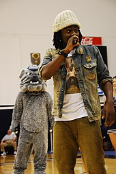 Wale rapping on stage