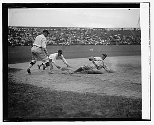 Wally Schang - Yankees catcher Wally Schanq slides safely into 3rd base. Senators 3rd baseman is Ossie Bluege and pitcher backing up play is Firpo Marberry.