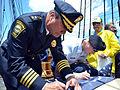 Watertown police chief signs flag 130604-N-SU274-403.jpg