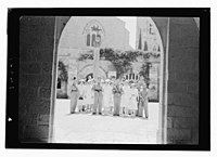 Wedding at St. George's Cathedral on June 3, 1942. Group through archway LOC matpc.12421.jpg