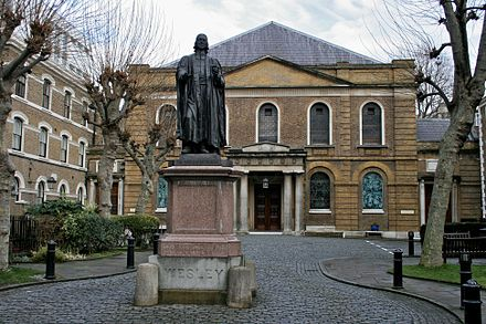 Wesley's Chapel in London was established by John Wesley, whose statue stands in the courtyard. Wesley's Chapel.jpg