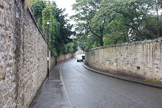 Inveresk - The western section of Inveresk Village is typified by high stone walls and mansion-houses screened by trees