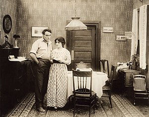 Willard Mack - Unemployed worker John Adams (Willard Mack) and his wife (Clara Williams) are faced with bills they cannot pay in a still from The Corner (1916).
