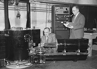 Clifford Shull - Clifford Shull (right), with Ernest Wollan, working with a double-crystal neutron spectrometer at the ORNL X-10 graphite reactor in 1949