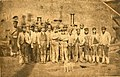 Workers at Neath Abbey Ironworks in front of steam locomotive, probably 'The Plymouth', ca 1870 (Neath Abbey Archives).jpg