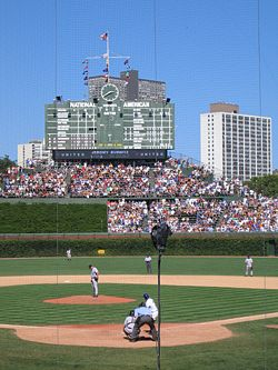 The main scoreboard at Wrigley Field. This photo was taken on the August 27, 2005 Cubs-Marlins game.  Note the video board below the scoreboard, as it was added in 2004.