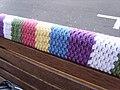Yarn bomb - park bench seat (5521005091).jpg