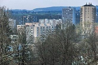 Hirzenbach - Apartment buildings in Hirzenbach as seen from Sagentobel valley on Adlisberg (April 2010)