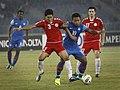 Zohib Islam Amiri (in red uniform) vs Jeje Lalpekhlua (in blue uniform).jpg