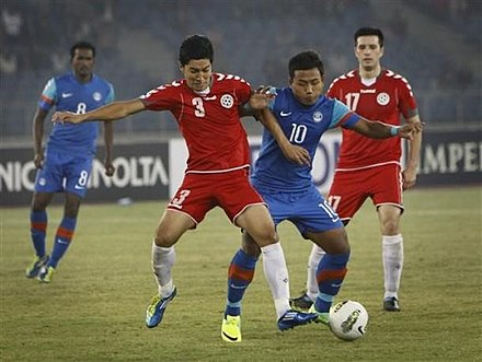 The Afghanistan national football team (in red uniforms) before its first win over India (in blue) during the 2011 SAFF Championship. Zohib Islam Amiri (in red uniform) vs Jeje Lalpekhlua (in blue uniform).jpg