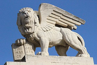 Generali Building - Close-up of winged lion statue on the roof