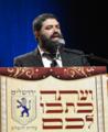 הרב עמוס שושן - בחידון השבת העולמי.png