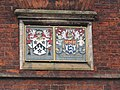-2020-01-14 Gresham's School coat of arms and the coat-of arms of the Worshipful Company of Fishmongers, School House, Station Road, Holt.JPG