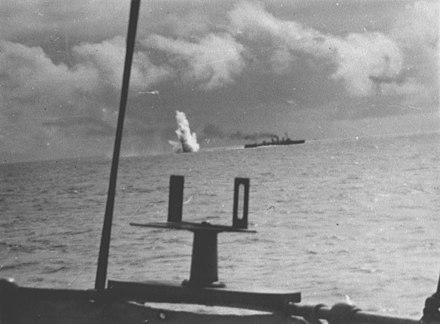 Scout cruiser of the Brazilian Navy launching depth charges to defend allied convoy in the Atlantic South. 036731 - Cruzador Bahia lancando uma bomba de profundidade. Foto tirada de bordo da Corveta Carioca (26171335744).jpg
