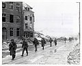 111-SC-236024 - U.S. Inf troops of the 30th Div on march through Malmedy which was leveled in error by U.S. bombers.jpg