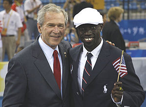 Lopez Lomong - Lomong with US President George W. Bush during the Opening Ceremony in Beijing