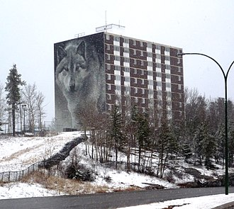 Thompson, Manitoba - Highland Tower, chosen for the Spirit Way wolf mural, is the most prominent building on Thompson's skyline